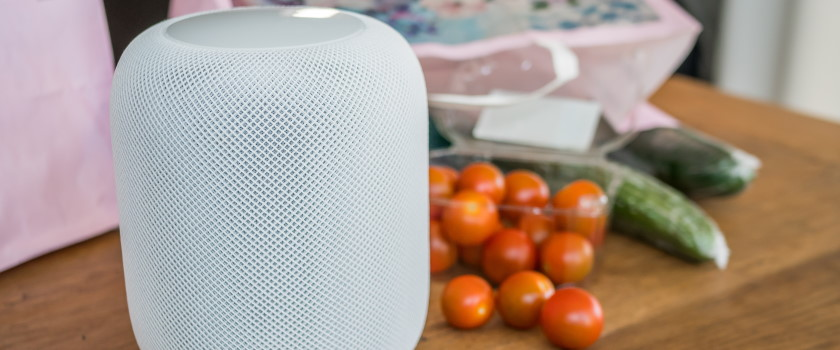 Smart speaker next to some grocery shopping in a kitchen