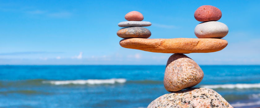 Rocks and pebbles stacked to be balancing on a beach