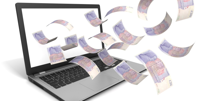 £20 notes flying out of a laptop