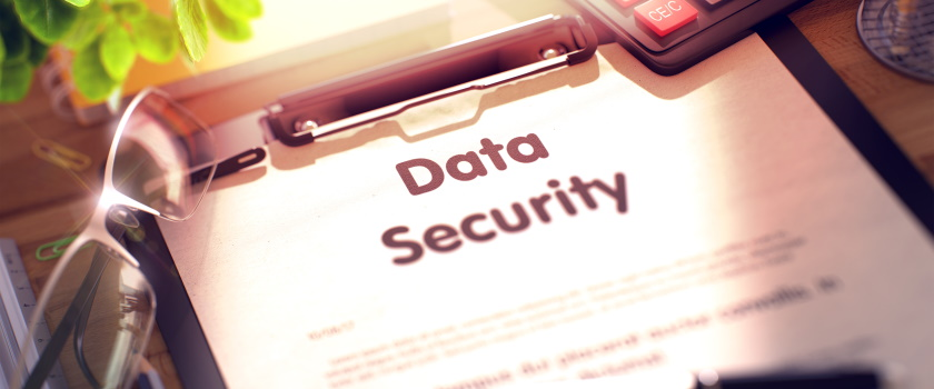 Data Security clipboard on a desk with glasses